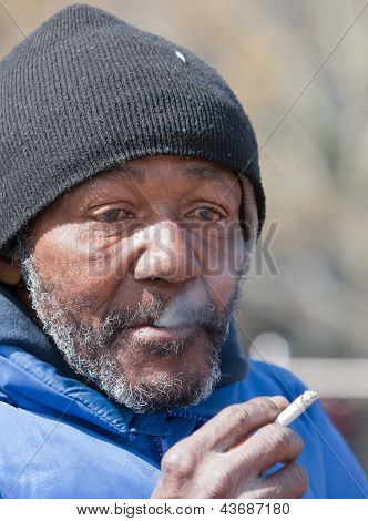 Homeless Man Smoking