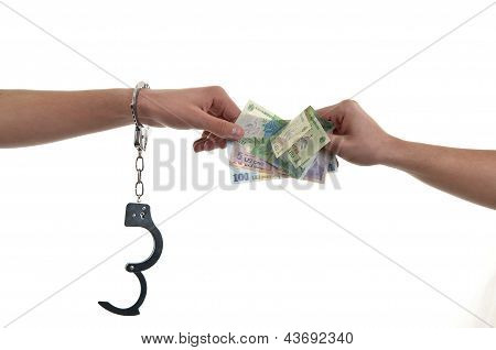 Hand In Handcuffs Giving Money