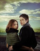Gorgeous Couple In Nature Against Dramatic Sky
