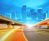 stock photo of florida-orange  - Abstract Illustration of an urban highway going to the modern city downtown - JPG