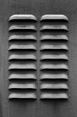 pic of louvers  - A dark gray metal ventilation louver with horizontal slats - JPG