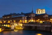 stock photo of nightfall  - Ile de la cite Paris Ile de France France - JPG