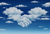 stock photo of cumulus-clouds  - Contract agreement vision in a meeting of a group of two cumulus clouds on a blue sky shaped as hands of business people coming together to form a strong collaboration for the future - JPG