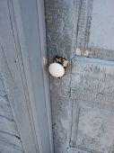 Old Door Handle And Cracked Paint