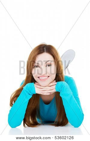 Beautiful woman lying and propping her head. Isolated on white.