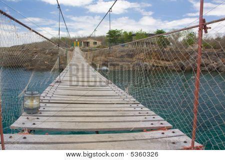 Old Wooden Bridge Across A Bay