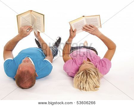 Two People Read A Book On The Floor