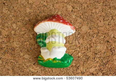 Fly Agaric From Plaster On A Wooden Background