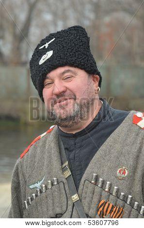 KIEV, UKRAINE -NOV 3 Member of Red Star history club wears historical uniform cossack of Corps von Panvits (German) during historical reenactment of WWII,  November 3, 2013 Kiev, Ukraine