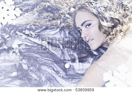 Young Woman With Snow And Snowflakes