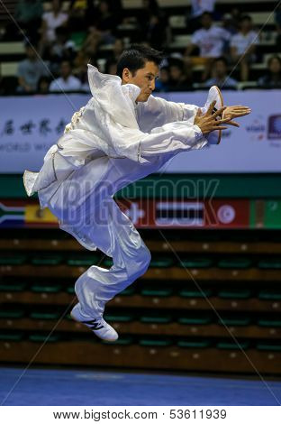 KUALA LUMPUR - NOV 03: Ang Babu Lama of Nepal shows his fighting style in the 'Taiji quan' event at the 12th World Wushu Championship on November 03, 2013 in Kuala Lumpur, Malaysia.