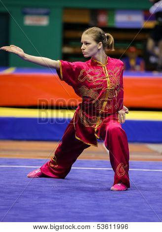 KUALA LUMPUR - NOV 03: Temna Liudmyla of Ukraine shows her fighting style in the 'changquan compulsory' event at the 12th World Wushu Championship on November 03, 2013 in Kuala Lumpur, Malaysia.