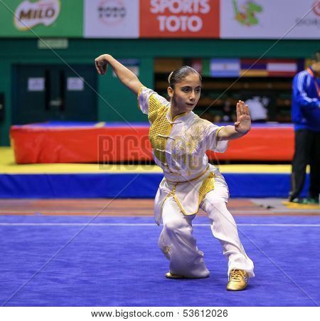 KUALA LUMPUR - NOV 03: Ilayda Emen of Turkey shows her fighting style in the 'changquan compulsory' event at the 12th World Wushu Championship on November 03, 2013 in Kuala Lumpur, Malaysia.