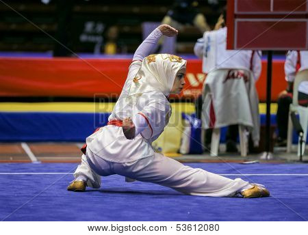 KUALA LUMPUR - NOV 03: Seyma Urhan of Turkey shows her fighting style in the 'changquan compulsory' event at the 12th World Wushu Championship on November 03, 2013 in Kuala Lumpur, Malaysia.