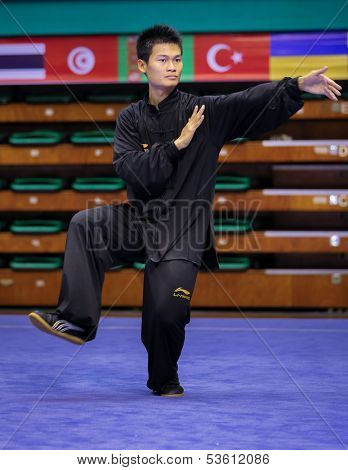 KUALA LUMPUR - NOV 03: Loh Jack Chang of Malaysia shows his fighting style in the 'Taiji quan' event at the 12th World Wushu Championship on November 03, 2013 in Kuala Lumpur, Malaysia.