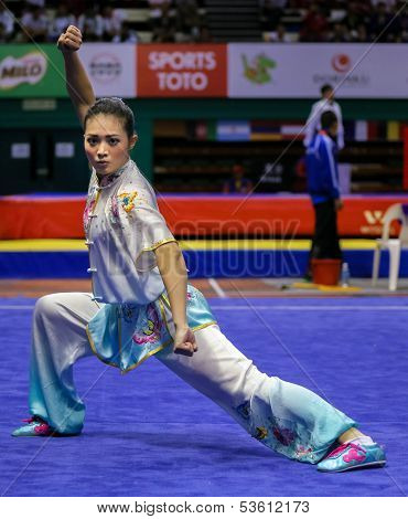 KUALA LUMPUR - NOV 03: Phoon Eyin of Malaysia shows her fighting style in the 'changquan compulsory' event at the 12th World Wushu Championship on November 03, 2013 in Kuala Lumpur, Malaysia.