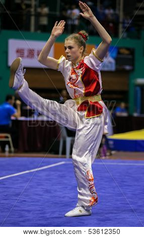 KUALA LUMPUR - NOV 03: Juliette Vauchez of France shows her fighting style in the 'changquan compulsory' event at the 12th World Wushu Championship on November 03, 2013 in Kuala Lumpur, Malaysia.