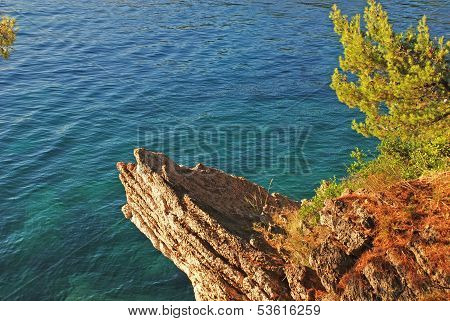 Turquoise Sea , Golden Cliffs And Green Pine
