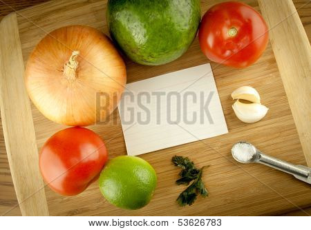 Cutting Board With Vegetables And Ingredients With Blank Recipe Card