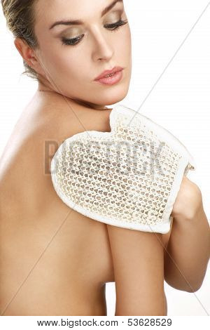 Close Up Of A Beautiful Woman Using A Scrub Glove
