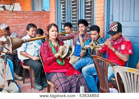 POKHARA, NEPAL-MAY 25. 2013: An unidentified Nepalese musicians play brass traditional instrumet on May 25, 2013 in Pokhara, Nepal. Pokhara is located about 210 km nort-west of Kathmandu.