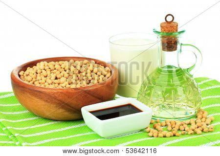 Soy products on table on white background