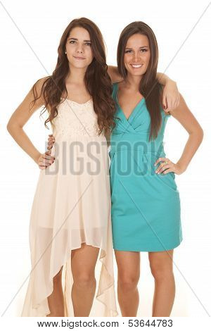 Two Women Dresses Arms Around Each Other Looking