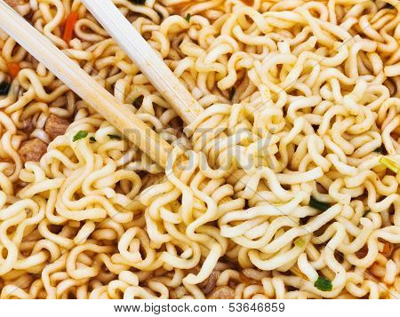 Eating Instant Noodles By Wooden Chopsticks