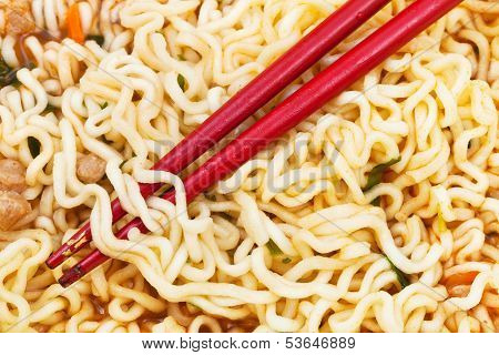 Red Chopsticks On Cooked Instant Ramen