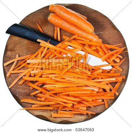 Wooden Cutting Board With Raw Strips Sliced Carrot