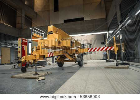 Yellow mobile industrial crane in a building