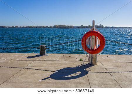 Life buoy next to a lake