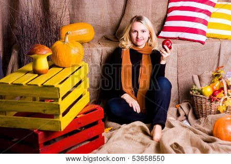 Woman Sits And Holds An Apple