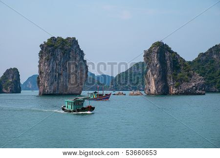 Rocky Islands And Boats In Halong Bay