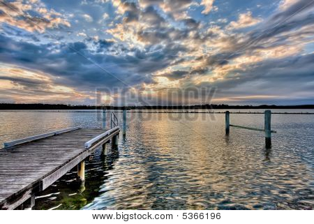 River Pier At Sunset, With Dramatic Cloudscape