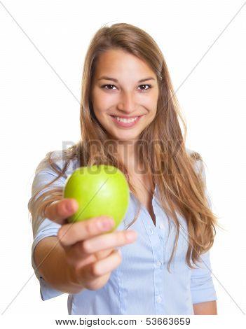 Beautiful woman offers an apple
