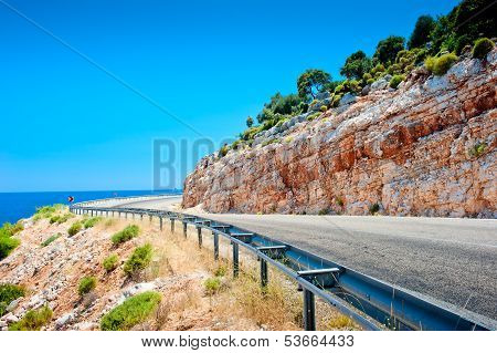 Highway Guardrail In The Mountains And Beautiful Rock