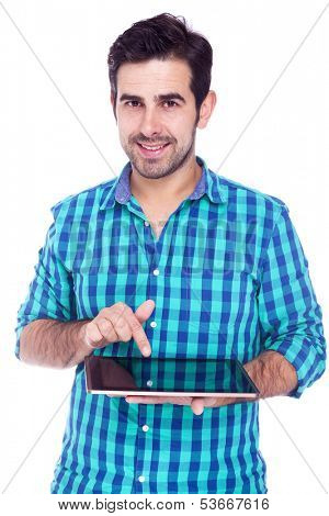 Handsome latin man using a tablet computer, isolated over a white background
