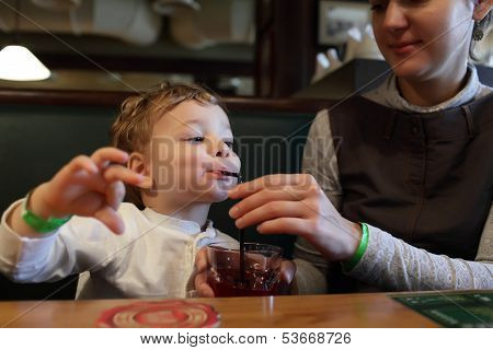 Child Drinks Juice