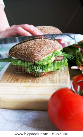 Housewife Divides Healthy Rye Bread Sandwich In Half