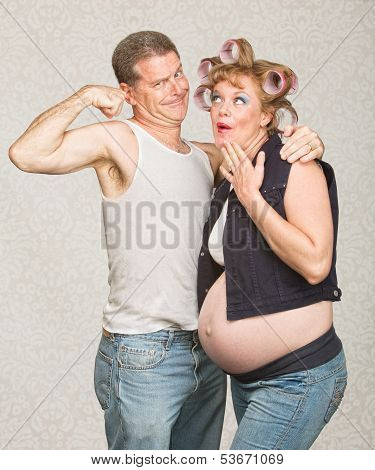 Man Showing Biceps To Pregnant Woman