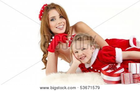 Beautiful woman and little girl dressed in costume santa claus