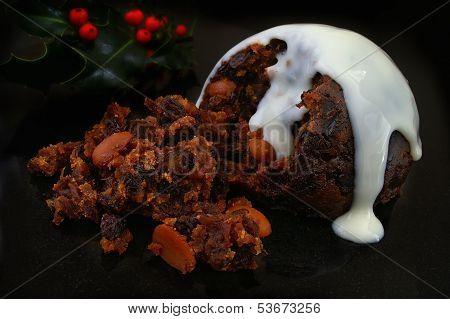 traditional English Christmas pudding with white sauce