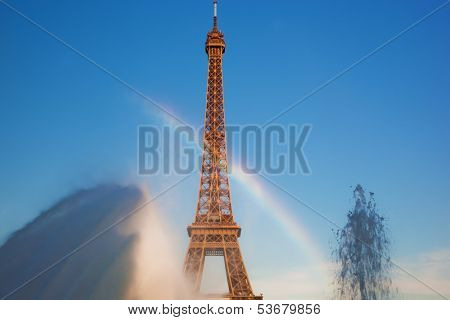 Eiffel Tower seen from fountain making natural rainbow at Jardins du Trocadero at a sunny summer day, Paris, France