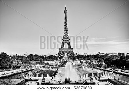 Eiffel Tower seen from fountain at Jardins du Trocadero at a sunny summer day, Paris, France. Black and white