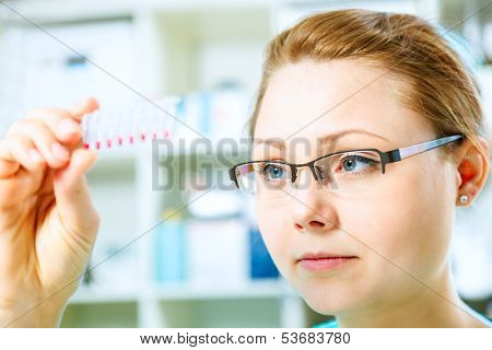 female tech or scientist works with pipette in biological laboratory