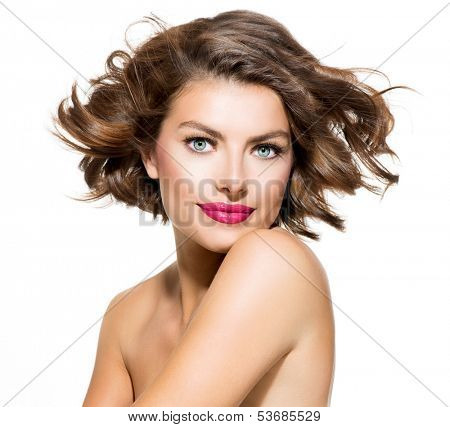 Beauty Young Woman Portrait Isolated over White Background. Beautiful Spa Model Girl Looking at Camera. Short Curly Hair, Fresh Clean Skin and Blue Eyes. Hairstyle. Haircut