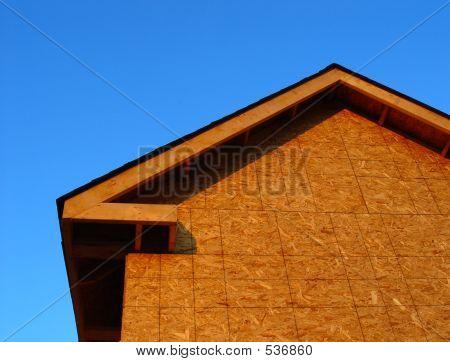 House Frame under Construction over Blue Sky