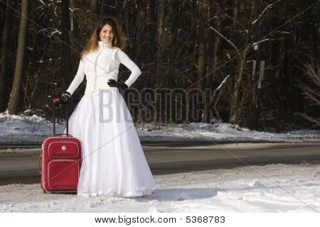 Eloping Bride In Winter With Bag