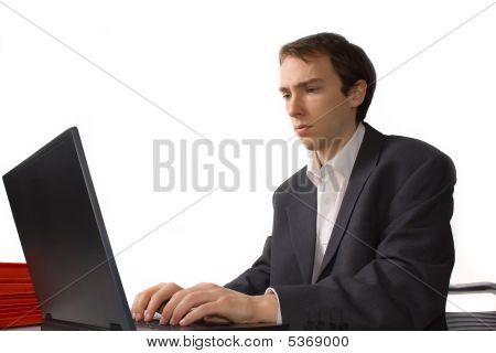 Concentrated Young Man Works On Laptop